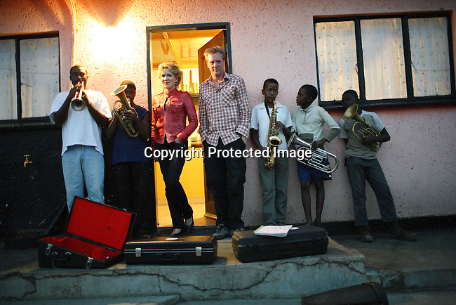 Petra Reski and Per-Anders Pettersson in Soweto. Youth members of a Brass band rehearse in the back yard of a home in Soweto.