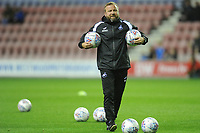 Billy Reid, assistant manager for Swansea during the pre-match warm-up for the Sky Bet Championship match between Wigan Athletic and Swansea City at the DW Stadium in Wigan, England, UK. Friday 02 October 2018