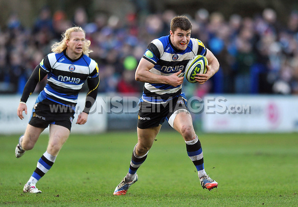 Ollie Devoto in possession. LV= Cup match, between Bath Rugby and Cardiff Blues on January 25, 2014 at the Recreation Ground in Bath, England. Photo by: Patrick Khachfe / Onside Images