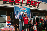 Fleet Feet St. Louis owner David Spetnagel speaks to the crowd just before introducing Meb Keflezghi at the Run with Meb promotion at the Des Peres store, Wednesday, September 3, 2014.