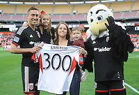 Washington, D.C.- March 29, 2014. Davy Arnaud (8) of D.C. United celebrating with his family his 300th game. D.C. United defeated the New England Revolution 2-0 during a Major League Soccer Match for the 2014 season at RFK Stadium.