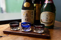 Sake taster set, Shoryu Ramen restaurant near Piccadilly Circus, London, UK, 5 May 2014. Sake rice wine has become popular in London. Many Japanese restaurants and bars serve sake by the glass and bottle. Sake cocktails are especially popular.