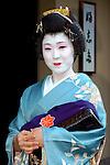Geisha Yoshimaru sets off for work in Tokyo, Japan.