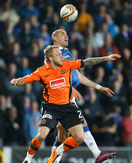 Madjid Bougherra wins the header from Johnny Russell