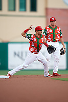 "Palm Beach Cardinals shortstop Jose Martinez (12) throws to first base during a game against the Charlotte Stone Crabs on July 22, 2017 at Roger Dean Stadium in Palm Beach, Florida.  The Cardinals wore special ""Ugly Sweater"" jerseys for Christmas in July.  Charlotte defeated Palm Beach 5-2.  (Mike Janes/Four Seam Images)"