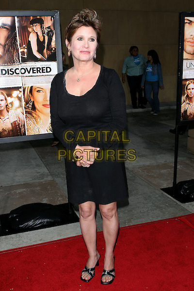 "CARRIE FISHER.Lions Gate World Premiere of ""Undiscovered"" held at The Egyptian Theater, Hollywood, 23rd August 2005.full length black dress strap sandals choes hands crossed.www.capitalpictures.com.sales@capitalpictures.com.© Capital Pictures."