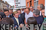 Enda Kenny is confronted by protesters in Newcastle West last Friday over the governments plans to cut bus service to rural schools across Ireland.