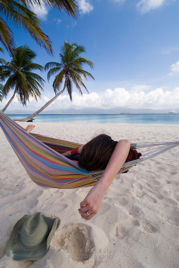 Hammock time on Isla Kuanidup, San Blas Islands, Panama..