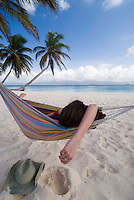 Hammock time on Isla Kuanidup, San Blas Islands, Panama..