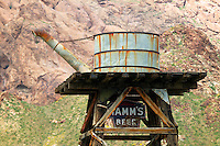 A water tank at an old restored gold mine and related equipment, near Lake Mohave, Nelson, Nevada