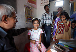 21 May 2013, Mandiganal Village, Karnartaka, India:   Dr Bellada of the Karnataka Mobile Health Clinic project conducts a check up on, Rajeshwari (9) in the Anganwadi centre at  Mandiganal Village. The World Bank is financing the Karnataka Health Systems Project that is bringing mobile health clinics to remote villages in Karnataka and covers the cost of an ambulance, a doctor, pharmacist, two nurses, a cleaner and a driver. Villagers have the opportunity to see a doctor once a week for basic services and will be referred to Primary Health Care centres for larger issues Picture by Graham Crouch/World Bank