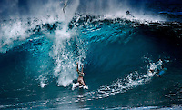 Surfer wipes out on a large winter wave at Banzai Pipeline on North Shore of Oahu.
