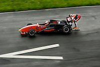 Dirk Auer wants to get a feeling for speed before he skates at full thrust to hang behind a dragster..Therefore he first wants to hang behind a Formula 3 racing car with 240 horsepower and a maximum speed of 270 km/h. Dirk Auer who is training every day up to 3 hours in the gym is already getting closer to his limits because he has to go down in a very deep racing position in order to grap the spoiler of the racing car. He is holding the spoiler just with his hands. Pilot Rudi Linner (37) is very nervous because he knows that Dirk has to handle brutal forces on the spoiler. Also if Dirk gets into a dangerous situation he can pull the car into trouble, too..Even in a racing suit, with leg protectors and a helmet, this remains a perilous trip for the Dirk Auer...But Dirk Auer, also known as the human rocket, is in perfect shape. After reaching 176 km/h in the first run, he decided to go full throttle directly in the second run. And so se reached 196 km/h. This was already maximum speed on that day because of the wet surface. They tyres didn´t get any more grip...