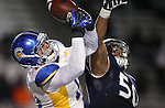 San Jose State's Billy Freeman and Nevada's Jonathan McNeal battle for the ball in an NCAA college football game in Reno, Nev., on Saturday, Nov. 16, 2013. (AP Photo/Cathleen Allison)