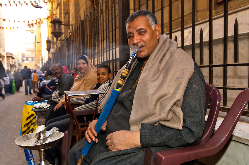 Man smoking water pipe (Sheesha), Khan el Khalili Bazaar, Old Cairo (Islamic Cairo), Cairo, Egypt