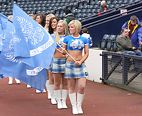 The Rockettes pre match carrying flags