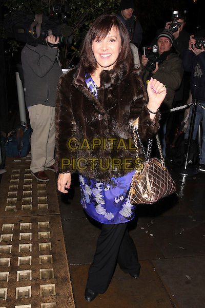 ARLENE PHILLIPS.Cecile & Hermione English National Ballet's Christmas VIP Party at St Martins Hotel, London, England..December 16th 2009 .full length coat jacket bag quilted blue print dress over black trousers bronze brown fur.CAP/AH.©Adam Houghton/Capital Pictures.
