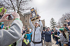 April 2, 2018; Holding up the championship trophy, senior Kat (Kathryn) Westbeld is greeted by fans as the Notre Dame women's basketball team arrives on campus Monday, following their win in the NCAA National Championship. (Photo by Barbara Johnston/University of Notre Dame)