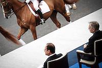 François Hollande, Président de la République, et le Premier Ministre, Jean-Marc Ayrault, assistent au défilé militaire sur les Champs Elysées le jour de la fête nationale. A Paris le 14 juillet 2012 - 2012©Jean-Claude Coutausse / french-politics pour Le Monde