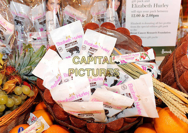 ATMOSPHERE.At a photocall to launch Elizabeth Hurley's new range of organic products at Harrods Food Hall, Harrods, Knightsbridge,.London, England, UK, .3rd November 2009.Liz food beef jerky  basket .CAP/FIN.©Steve Finn/Capital Pictures.