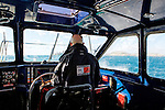 Onboard a Pilot Boat transiting from the Marseille Old Port to the Frioul Islands, Marseille, France.<br /> A pilot boat is a type of boat used to transport pilots between land and the inbound or outbound ships that they are piloting.<br /> Nestled in the rocks of Friuli, the pilot house, built in 1950, to the sea looks like a ship ready to emerge. The Pilot Port of Marseilles have always camped on the island of Ratonneau, waiting for the vessels bound for the southern entrance of the port of Marseille, before control passes to the city of Marseille