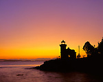 San Juan Island, WA: Sunset afterglow silhouetting the Lime Kiln Lighthouse, Lime Kilm Point State Park on Haro Strait