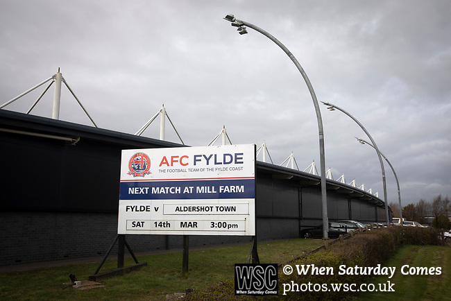 AFC Fylde 1, Aldershot Town 0, 14/03/2020. Mill Farm, National League. A sign advertising the day's fixture before AFC Fylde took on Aldershot Town in a National League game at Mill Farm, Wesham. The fixture was played against the backdrop of the total postponement of all Premier League and EFL football matches due to the the coronavirus outbreak. The home team won the match 1-0 with first-half goal by Danny Philliskirk watched by a crowd of 1668. Photo by Colin McPherson.