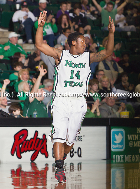 North Texas Mean Green guard Trey Norris (14) in action during the game between the Louisiana Lafayette Ragin Cajuns and the University of North Texas Mean Green at the North Texas Coliseum,the Super Pit, in Denton, Texas. Louisiana Lafayette defeats UNT 57 to 53.