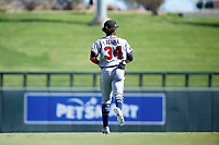 Peoria Javelinas center fielder Ronald Acuna (34), of the Atlanta Braves organization, jogs onto the field between innings of an Arizona Fall League game against the Salt River Rafters on October 16, 2017 at Salt River Fields at Talking Stick in Scottsdale, Arizona.  Peoria defeated Salt River 6-2.  (Zachary Lucy/Four Seam Images)