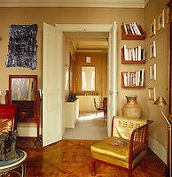 The parquet flooring is an original feature and has been left uncovered in the study where it adds to the texture of the overall design