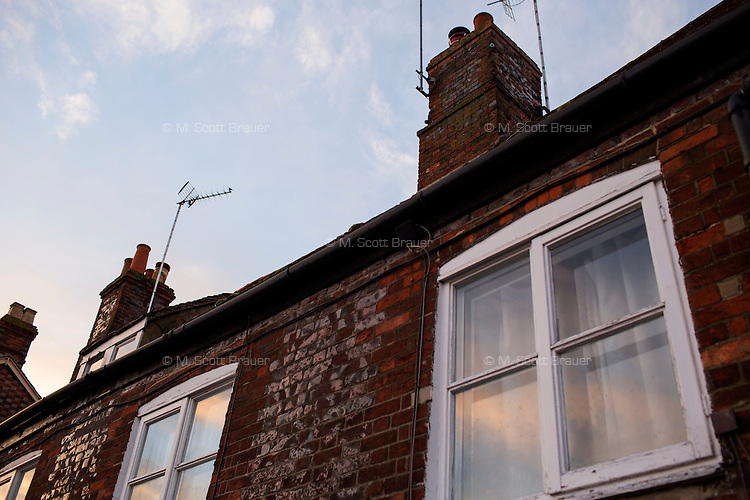 A view of houses and shop buildings in downtown Wantage, Oxfordshire, England.