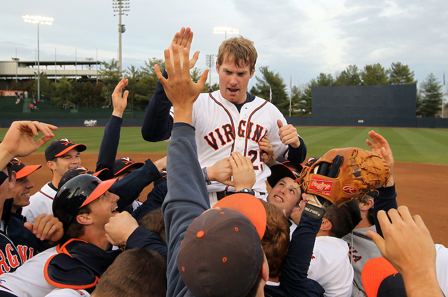 March 29, 2011 - Charlottesville, VA. USA; From left, Virginia pitcher Will Roberts is lifted up by his teammates after completing the first perfect game in school history against George Washington Tuesday night at Davenport Stadium. It's the 8th 9-inning perfect game in NCAA Division 1 play since 1957. Photo/Andrew Shurtleff