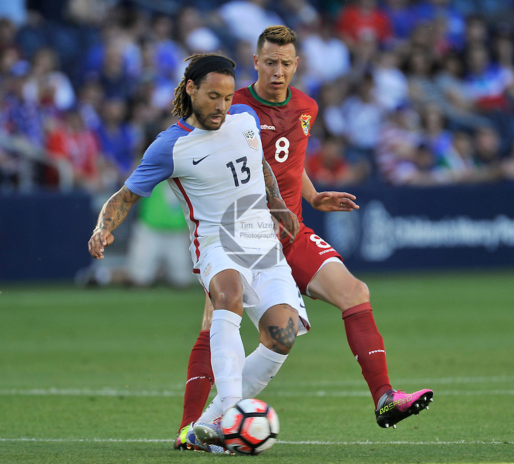The Bolivian Men's National Team traveled to Kansas City, Kansas to play an international friendly game against the USA Men's National Team on Saturday May 28, 2016. The game was a warmup for both teams as they prepare for the upcoming Copa America. United States midfielder Jermaine Jones (13) shields the ball from Bolivia midfielder Martin Smedberg-Dalence (8) in late first half action.
