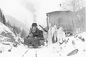 D&amp;RGW #473 taking on water at Nedleton water tank.  Engineer in front with oil can.<br /> D&amp;RGW  Needleton, CO  Taken by Richardson, Robert W. - 2/5/1951