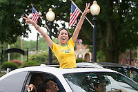 Danbury, CT - Thursday, June 12, 2014: Brazil fan Viviane Gondinho of Danbury cheers while taking part in a impromptu parade down Main Street to celebrate Brazil's victory over Croatia in their World Cup opening match.