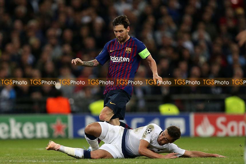 Harry Winks of Tottenham Hotspur and Lionel Messi of FC Barcelona during Tottenham Hotspur vs FC Barcelona, UEFA Champions League Football at Wembley Stadium on 3rd October 2018