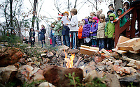 NWA Media/DAVID GOTTSCHALK - 12/19/14 - A fire burns during the Winter Solstice Celebration at Walnut Farm Montessori School in Bentonville Friday December 20, 2014. The school held a celebration inviting friends and family to enjoy cookies, cider, hot chocolate and listen to songs and poems by the students and faculty in the Natural Playground.