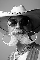 cowboy 7/25/09- Jim Hartzler, of Mesa, 59, (CQ) placed first in Saturday's Wyatt Earp-Holliday Mustache Contest held at the Goldfield Ghost Tow in Apache Junction. The contest was held during their celebration for National Day of the Cowboy. (Pat Shannahan/ The Arizona Republic)