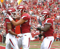 NWA Media/ANDY SHUPE - Arkansas receiver Keon Hatcher, left, celebrates a touchdown with tight end Hunter Henry, center, against Nicholls during the second quarter Saturday, Sept. 6, 2014, at Razorback Stadium in Fayetteville