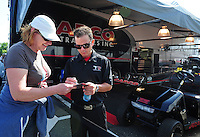 Jun. 2, 2012; Englishtown, NJ, USA: NHRA top fuel dragster driver Steve Torrence signs autographs for fans during qualifying for the Supernationals at Raceway Park. Mandatory Credit: Mark J. Rebilas-