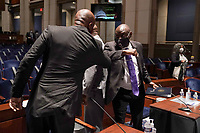 Ben Crump, civil rights attorney representing George Floydís family, elbow bumps Paul Butler, law professor at Georgetown University Law Center, after a United States House Judiciary Committee hearing to discuss police brutality and racial profiling on Wednesday, June 10, 2020.<br /> Credit: Greg Nash / Pool via CNP/AdMedia