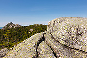 The exposed Middle Sister Trail in the White Mountains, New Hampshire USA. Mount Chocorua is in the background