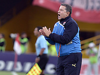 BOGOTÁ -COLOMBIA, 29-09-2013. Pedro Sarmiento técnico del Medellín gesticula durante partido  por la fecha 12 de la Liga Postobon II 2013 disputado en el estadio el Campín de la ciudad de Bogotá./ Medellin coach Pedro Sarmiento gestures during match against Santa Fe of the 12th date for the Postobon League II 2013 played at El Campin stadium in Bogotá city. Photo: VizzorImage/Gabriel Aponte/STR