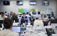 NWA Democrat-Gazette/CHARLIE KAIJO Supply specialists work on the logistics of keeping stores stocked with needed merchandise in the hurricane zones at the Wal-Mart Home and Office Emergency Operations Center in Bentonville, AR on Friday, September, 8, 2017. The Wal-Mart Emergency Operations Center (EOC) has been a hub of activity the past couple of weeks because of the Hurricane Harvey and Hurricane Irma.