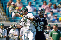 February 20, 2011:  Jacksonville Dolphins defender Corey Lovrich (88) fights off Georgetown Hoyas defender Barney Ehrmann (43) during Lacrosse action between the Georgetown Hoyas and Jacksonville Dolphins during the Moe's Southwest SunShine Classic played at EverBank Field in Jacksonville, Florida.  Georgetown defeated Jacksonville 14-11.