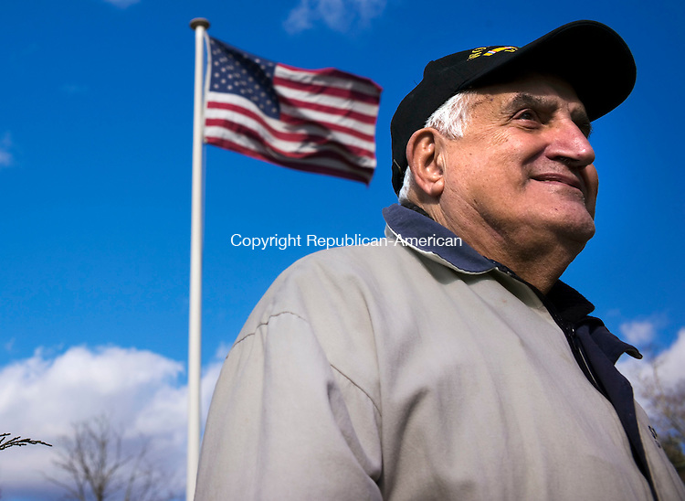 Woodbury, CT- 08 November 2015-110815CM08-  Edward Manzi of  Woodbury and a U.S Army and Korean War veteran listens in during a ceremony at the Woodbury Cannon Green on Sunday. Town leaders and veterans groups held a ceremony in honor of Veterans Day, which will Wednesday, November 11.      Christopher Massa Republican-American