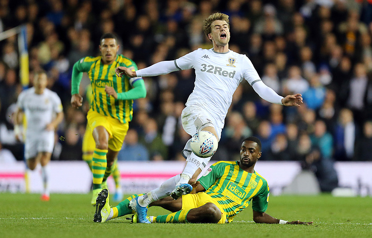 Leeds United's Patrick Bamford is fouled by West Bromwich Albion's Semi Ajayi<br /> <br /> Photographer Rich Linley/CameraSport<br /> <br /> The EFL Sky Bet Championship - Tuesday 1st October 2019  - Leeds United v West Bromwich Albion - Elland Road - Leeds<br /> <br /> World Copyright © 2019 CameraSport. All rights reserved. 43 Linden Ave. Countesthorpe. Leicester. England. LE8 5PG - Tel: +44 (0) 116 277 4147 - admin@camerasport.com - www.camerasport.com