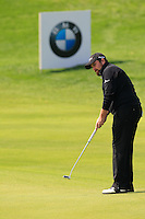 Shane Lowry (IRL) putts on the 9th green during Sunday's Final Round of the 2014 BMW Masters held at Lake Malaren, Shanghai, China. 2nd November 2014.<br /> Picture: Eoin Clarke www.golffile.ie