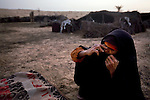 Sabeha, a Bedouin woman, sits outside her home in the desert in the Sinai peninsula, not far from the border with Israel, Jan. 28, 2010. Some Bedouin make a living smuggling goods and humans from Egypt across the Gaza and Israel borders. A barrier wall being built buy Egypt may impact the illegal trade, causing strife between the government and Egypt's marginalized Bedouin tribes.