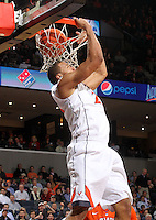 Virginia guard Justin Anderson (23) dunks the ball on an alley oop during the game against Clemson Thursday in Charlottesville, VA. Virginia defeated Clemson 78-41.